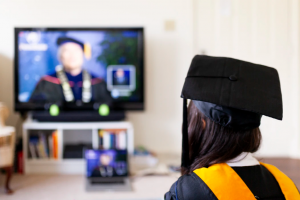 Graduate student watching a screen